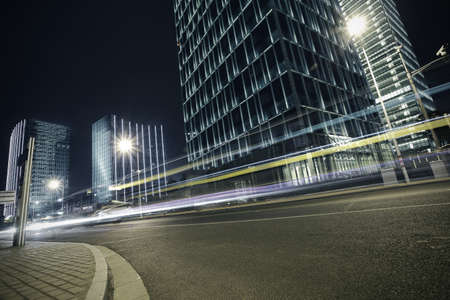 Bottom angle shooting highway car light trails of modern urban buildings  photo