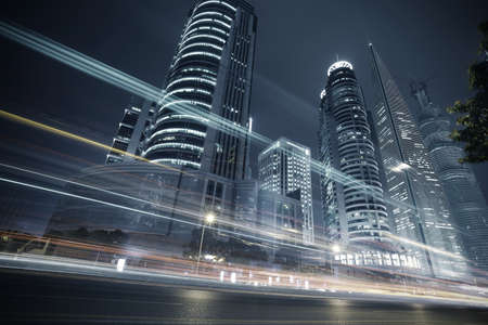Bottom angle shooting highway car light trails of modern urban buildings  Stock Photo