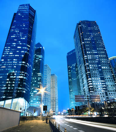 Dreamy blue of modern office buildings at night in Far East photo