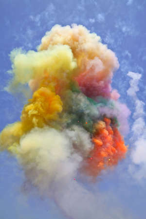 descriptive color: Holiday in the colorful explosion of smoke in the air Stock Photo