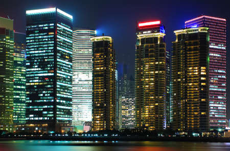 Photo of modern buildings by Huangpu river at night Pudong Lujiazui Skyline Shanghai, China photo