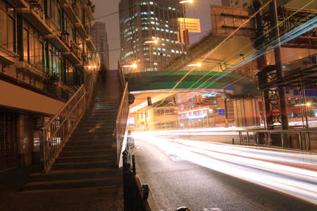 Night light trails on the modern building background in Highway  photo