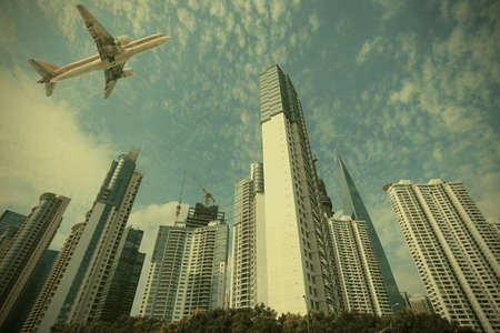 Shanghai,Aircraft is flying in the modern urban buildings   photo