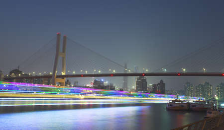 bridge footing: Modern steel cable-stayed bridge beams at night in Shanghai