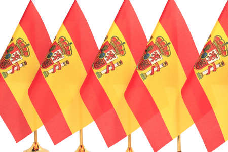 Spain flags hanging on the gold flagstaff, Isolated on the white background photo