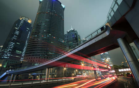 The light trails on the modern buildings background in shanghai china photo