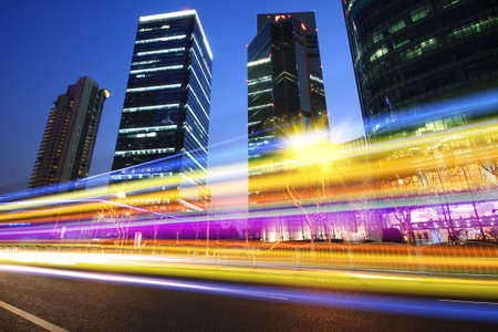 Modern office building rainbow ray background night in Shanghai photo