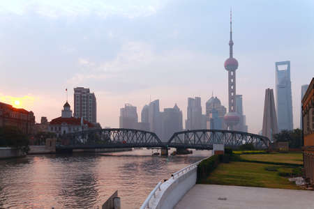 Shanghai Bund medieval garden bridge at sunrise skyline