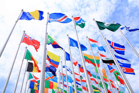 British Commonwealth and France flags and world national flags is flying Stock Photo