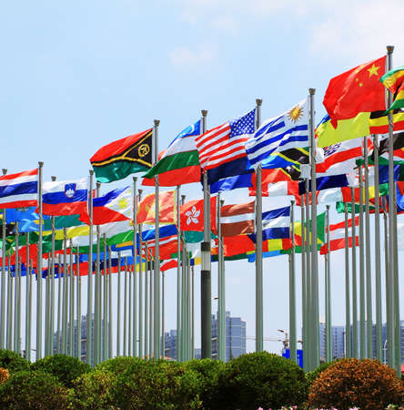 CHINA and USA Flags of all nations of the world are flying in blue sunny sky Stock Photo