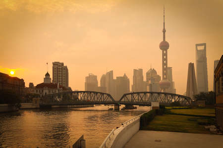 Shanghai Bund medieval garden bridge at sunrise skyline Stock Photo - 28424681
