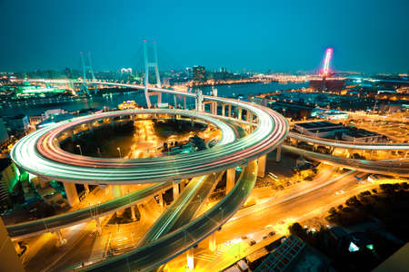 urban architecture: Asias largest across the rivers in Shanghai landmarks a spiral bridge at night