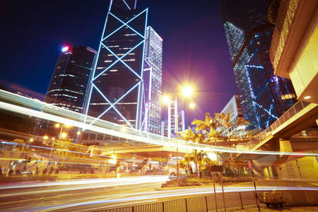 City road light trails of modern landmark buildings backgrounds in HongKong