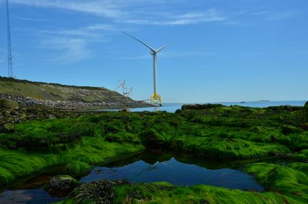 Wind Turbine at Coast Stock Photo