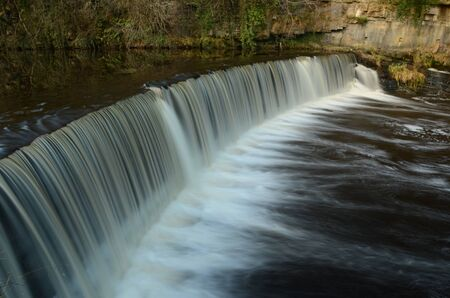 lothian: Weir on River Almond Stock Photo
