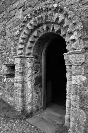 A view of the medieval chapel of St. oran beside the Abbey at Iona Stok Fotoğraf - 105727920