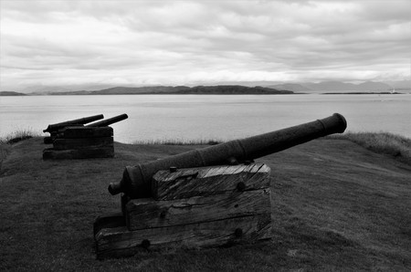 Ancient cannons outside the curtain wall of Duart castle on the isle of Mull