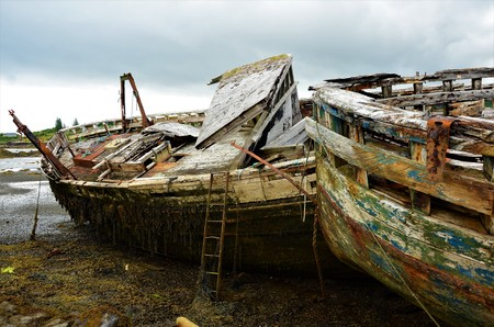 A view of rusting and rotting boats in Salen bay on the Isle of Mull