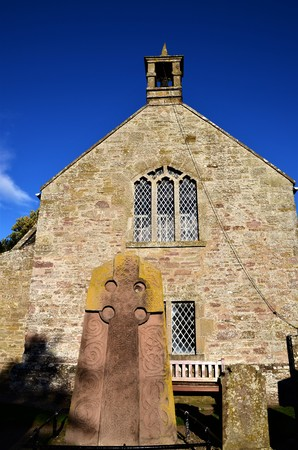 A view of a medieval sculptured stone of Pictish origin outside the church in Aberlemno Banco de Imagens