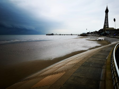 A view along the beach toward some of the iconic landmarks of the popular holiday resort town of Blackpool