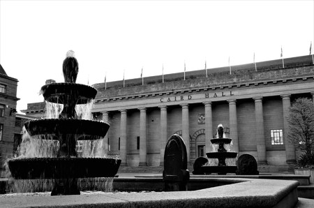 An exterior view of a concert hall and outdoor fountain in Dundee
