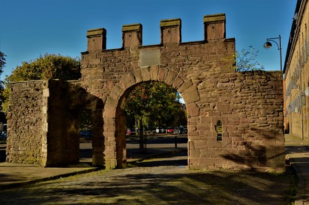 A section of medieval stone wall with arch in Dundee