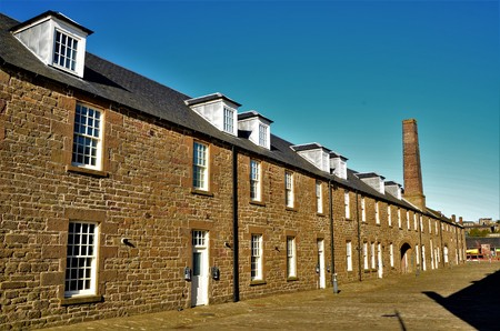 An exterior view of old stone brick buildings near the riverside and harbour area of Dundee