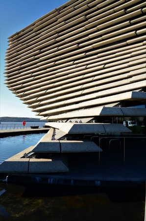 An exterior view of a new museum building on the shore of the river Tay in Dundee Editorial
