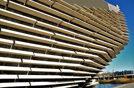 An exterior view of a new museum building on the shore of the river Tay in Dundee