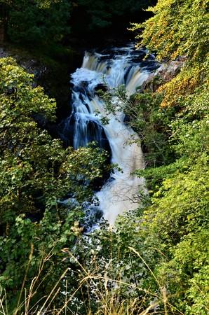 A view of the cascades of the Reekie Linn Waterfalls in Glenisla, Perthshire 版權商用圖片