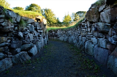 A view of the remains of an Iron age Earth House in Tealing near Dundee, Scotland Stock Photo