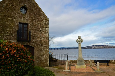 A view of the war memorial in a Celtic cross style stone monument at woodhaven Harbour