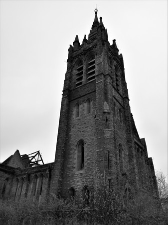 An exterior view of an old church tower in the North Lanarkshire town of Coatbridge. Stock fotó