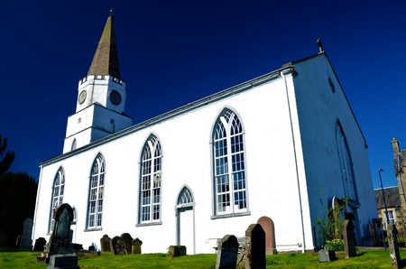 A view of the white church building on the banks of the river Earn in Comrie, Perthshire Stock Photo