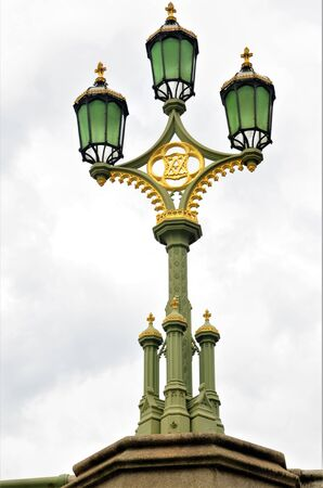 A view of a decorative lamp post on the Westminster Bridge in the City of London