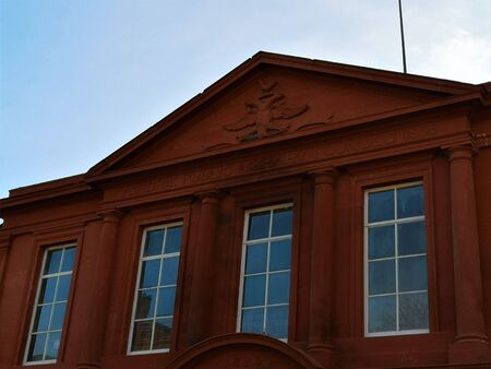 An external view of a red sandstone building which houses the Library in the town of Airdrie in Scotland.