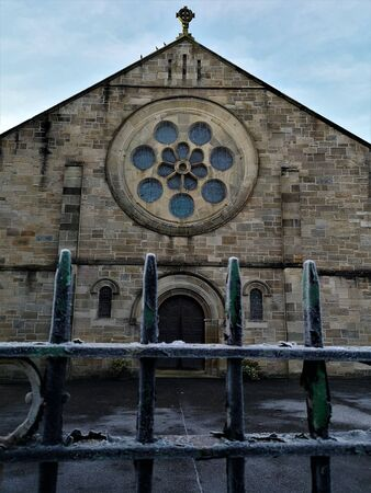 An external view of a stone church building in the town of Airdrie in Scotland.