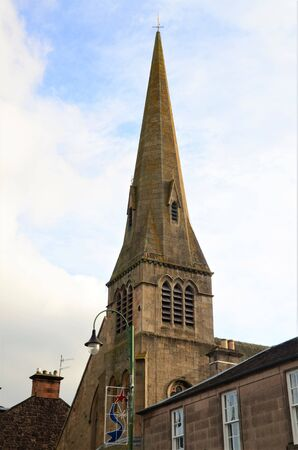 An exterior view of a church building in the town of Biggar in Scotland.