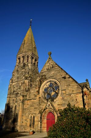 An external view of an old stone church building in the town of Broxburn in Scotland.