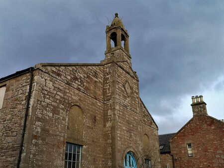 An external view of an old stone church building in the town of Carnwath in Scotland.