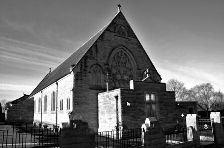 An external view of an old stone church building in the town of Chapelhall in Scotland.