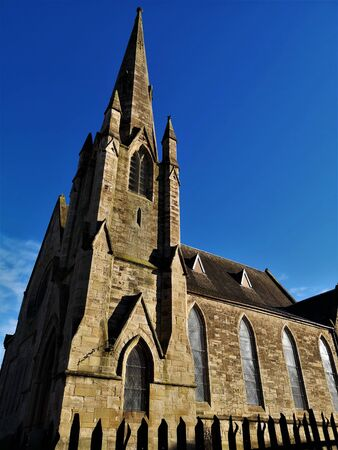 An external view of an old stone church building in the town of Coatbridge in Scotland.