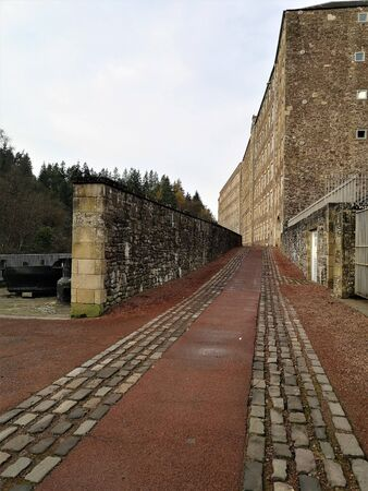 An external view of the rows of stone buildings in the heritage town of New Lanark in Scotland Stock Photo