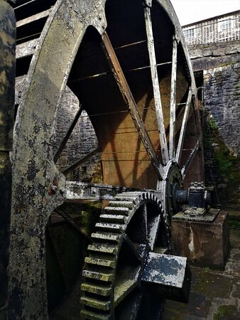 A view of an old water wheel in an old mill in the Heritage village of New Lanark