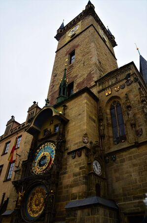 A view of the architectural detail of a church tower building in the Czech city of Prague.