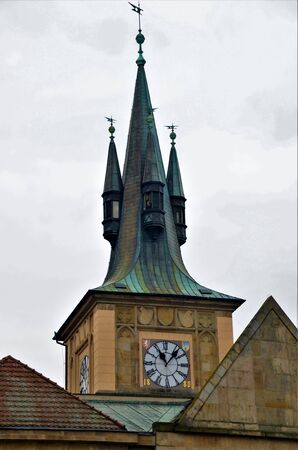 An external view of one of the many high clock tower spires in the Czech city of Prague Stock Photo