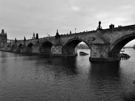 A view of the architecture of Charles Bridge and the surrounding buildings in the Czech city of Prague Stock Photo