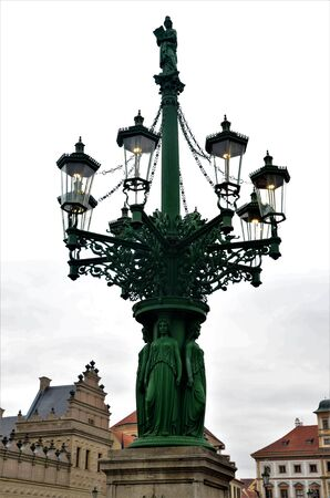 A view of an elaborate lamp post in the Old Town of Prague in the Czech Republic
