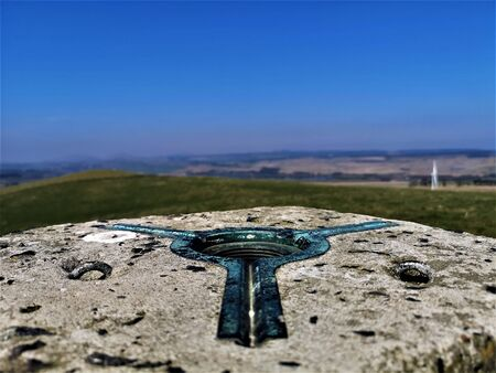 A view of a triangulation pillar on the summit of Hill of Beath in Fife.