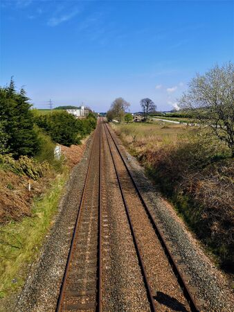 A view along a straight stretch of railway track at Crossgates in Fife.